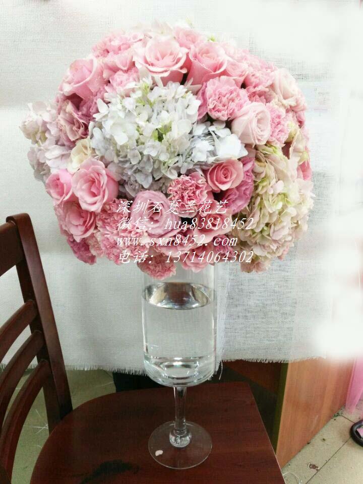 石夏兰玻璃瓶花,结婚鲜花,活动用花,布置庆典玻璃瓶插花,新品发布花,深圳科技园鲜花图片展示。