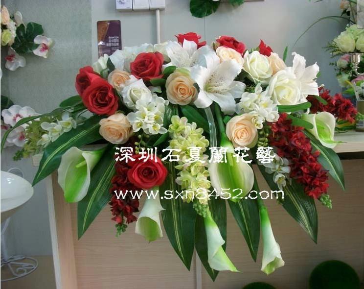石夏兰会议室摆放仿真花艺鲜花图片展示。