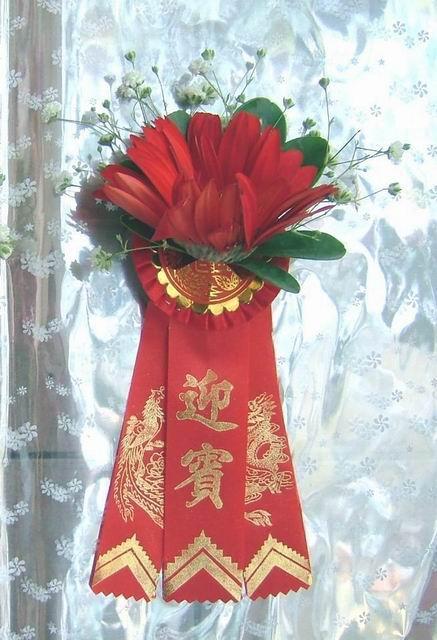 石夏兰扶朗迎宾胸花鲜花图片展示。