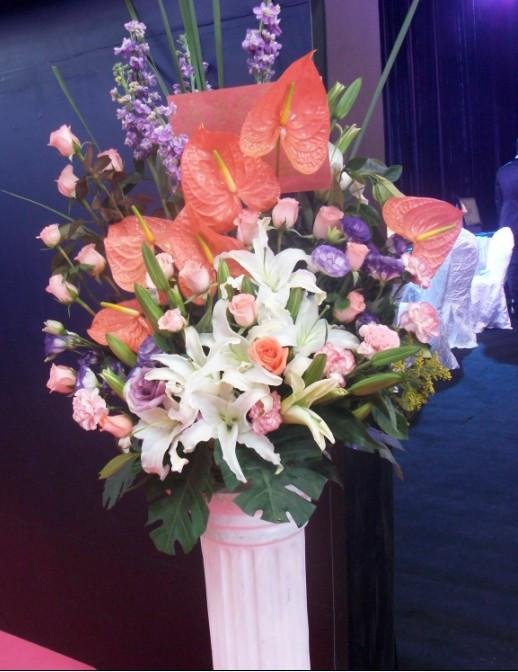 石夏兰展览会花篮,会展中心,罗马柱,开业花篮鲜花图片展示。