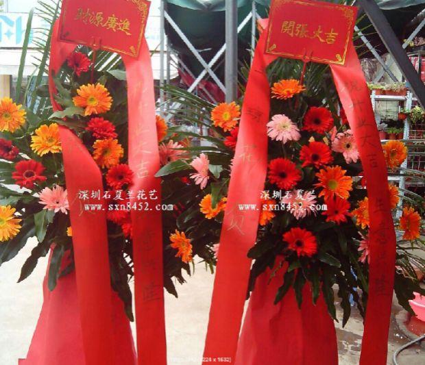 石夏兰港式花篮,艺术花篮,花材,太阳花,配草,包装,西式花篮,红色系花篮鲜花图片展示。
