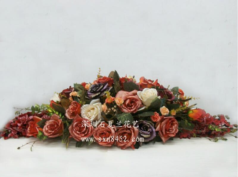 石夏兰高仿真花会议室台面花鲜花图片展示。
