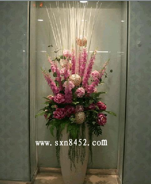 石夏兰酒店大堂仿真花鲜花图片展示。